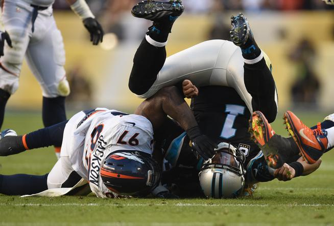 SANTA CLARA, CA - FEBRUARY 07: Malik Jackson (97) of the Denver Broncos brings down Cam Newton (1) of the Carolina Panthers after he releases a pass in the second quarter. The Denver Broncos played the Carolina Panthers in Super Bowl 50 at Levi's Stadium in Santa Clara, Calif. on February 7, 2016. (Photo by AAron Ontiveroz/The Denver Post)